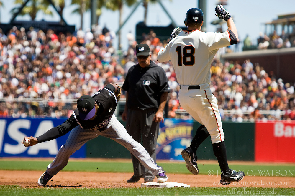 May 1, 2010; San Francisco, CA, USA;  San Francisco Giants starting pitcher Matt Cain (18) reaches first on an error by Colorado Rockies second baseman Eric Young Jr. (3) during the second inning at AT&T Park.  San Francisco defeated Colorado 6-1.