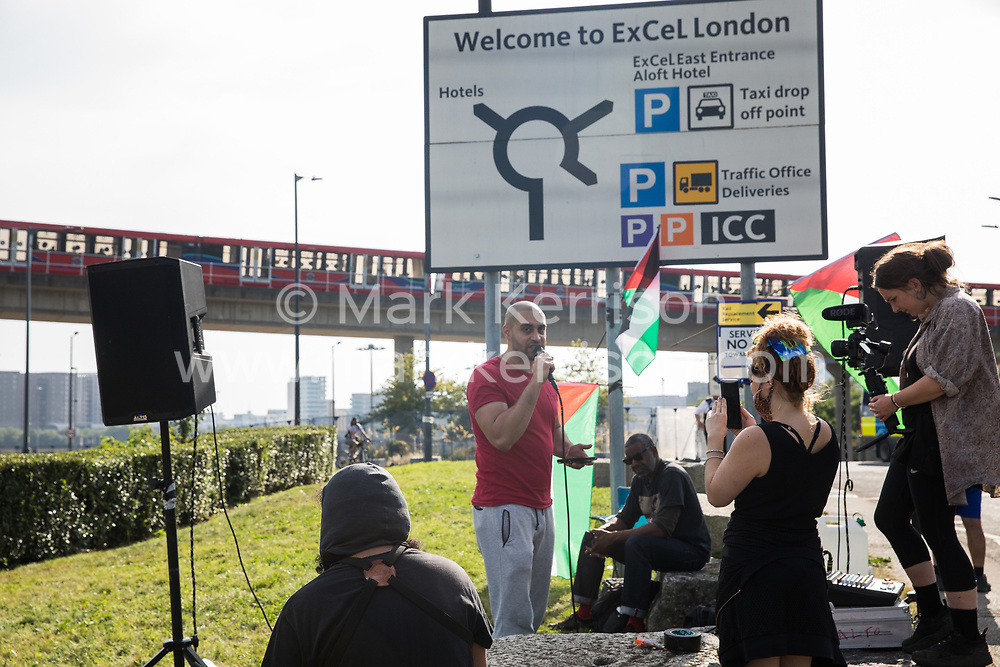London, UK. 6th September, 2021. Rapper Lowkey addresses human rights activists outside ExCeL London as preparations take place for the DSEI 2021 arms fair. The first day of week-long Stop The Arms Fair protests outside the venue for one of the world's largest arms fairs was hosted by activists calling for a ban on UK arms exports to Israel.