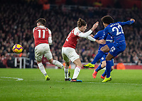 Football - 2018 / 2019 Premier League - Arsenal vs. Chelsea<br /> <br /> Willian (Chelsea FC)  tries his trademark curling shot as he squeezes his chance between Hector Bellerin (Arsenal FC) and Lucas Torreira (Arsenal FC) at The Emirates.<br /> <br /> COLORSPORT/DANIEL BEARHAM