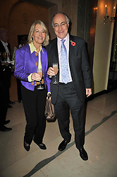 MICHAEL & SANDRA HOWARD at a party to celebrate the publiction of 'No Invitation Required' by Annabel Goldsmith, held at Claridge's, Brook Street, London on 11th November 2009.