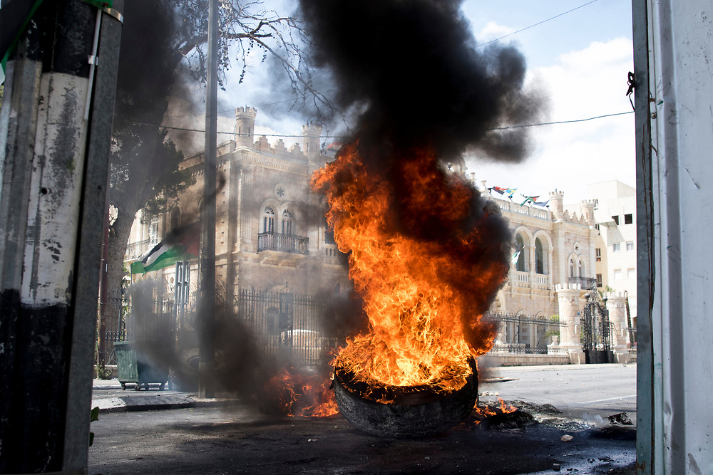 Bethlehem, Palestine. 15 May 2018. Burning barricade during clashes with Israeli soldiers on the 70th anniversary of the Nakba (Catastrophe) when over 700,000 Palestinians were forcibly moved from their homes during the creation of Israel. © Craig Redmond