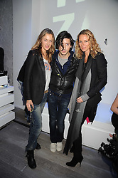 Left to right, CECILIA BOMSTROME, CARL BARAT and CAROLE GERLAND Creative Director of Zadig & Voltaire at a party hosted by Kate Sumner at Zadig & Voltaire to celebrate the brand's arrival in London at 182 Westbourne Grove, London W11 on 14th October 2008.