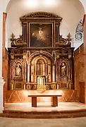 Elaborately decorated altar inside Iglesia Santo Cristo de la Salud, Malaga, Spain