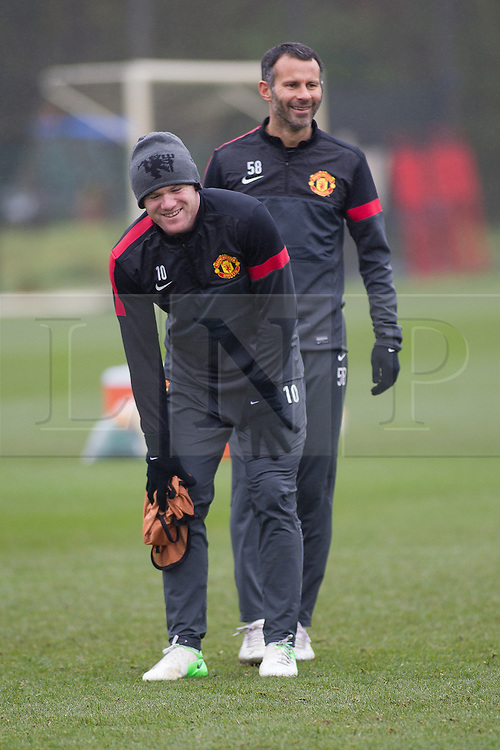 © Licensed to London News Pictures . 06/11/2012 . Manchester , UK . Wayne Rooney and Ryan Giggs . Manchester United players train this morning (6th November 2012) at the club's training facility in Carrington , ahead of their Champions League match against SC Braga in Portugal tomorrow (7th November 2012) . Photo credit : Joel Goodman/LNP