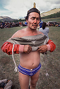 """Mongolian wrestling (Mongolian: bökh) is a traditional sport that has existed in Mongolia for centuries.<br /> Wrestling is one of Mongolia's age-old """"Three Manly Skills"""" (along with horsemanship and archery).<br /> The wrestler is dressed in an open-chested wrestling shirt, called a zodog."""