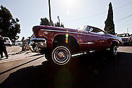 """A red lowrider rolls by on 3 wheels outside the church.<br />  Funeral services for Kevin """"Flipside"""" White at Macedonia Church in Watts.<br /> White was shot dead in what is believed to be an unprovoked attack during a gang conflict at Watts' Nickerson Gardens and Jordan Downs housing projects.<br /> Flipside, 44, was a founding member of Watts' first major label hip hop act, O.F.T.B. (Operation From The Bottom)."""