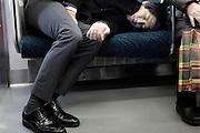 deep sleeping businessman during his train commuting Japan Tokyo