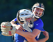 Freeburg pitcher Lizzy Ludwig (right) hugs catcher Maddy Schwemmer after Freeburg defeated Nashville in the Class 2A sectional softball title game at Nashville High School in Nashville, IL on Thursday June 10, 2021. Tim Vizer/Special to STLhighschoolsports.com.