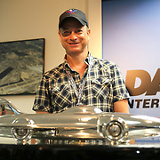 Actor Gary Sinise poses with the Harley J. Earl trophy during the 56th Annual NASCAR Daytona 500 race at Daytona International Speedway on Sunday, February 23, 2014 in Daytona Beach, Florida.  Sinise is the Grand Marshal for the race. (AP Photo/Alex Menendez)