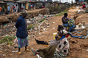 Residents go about their business inside Kibera Slum, Nairobi. Considered to be the largest slum in Africa with a population close to 1 million people. The living conditions in it  are considered of extreme poverty with most housholds having no runing water or sanitation. The population is made up of all ethno-linguistic groups of Kenya drawing many residents from the poorest rural backgrounds.