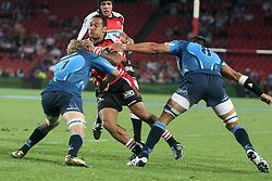 Lions player James Kamana and Two Bulls players left to right, Gurthro Steenkamp and Pierre Spies.19 February 2011, Gauteng Lions v Blue Bulls, Vodacom Super 15, CocaCola Park, Johannesburg, South Africa,.photo by Abbey Sebetha, Eagency