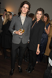 MAX HURD and ELEANOR CALDER at the launch of La Maison Remy Martin pop-up private members club at 19 Greek Street, Soho, London on 2nd November 2015.