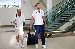 England's Stuart Broad as the team arrive at Adelaide Airport.