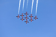 Canadian Forces Snowbirds completing a loop in the Big Diamond formation with smoke.  The Snowbirds are also known as the 431 Air Demonstration Squadron and fly the Canadair CT-114 Tutor jet. Photographed during the Canada 150 celebrations in White Rock, British Columbia, Canada.