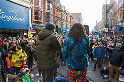 London, UK. 9th February, 2019. MC Dizraeli (l) entertains activists from Extinction Rebellion blocking Kingsland Road in Dalston as part of a 'Saturday street party' intended as a means of engagement around climate change and environmental issues with the local community.