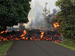 May 6, 2018 - Hawaii, U.S. - A lava flow moves on Makamae Street in Leilani Estates at 09:32 am HST. Homes destroyed by Hawaii's Kilauea volcano has climbed to at least 30. Lava has been spewing more than 200 feet in the air. More than 1,700 people evacuated. (Credit Image: ? USGS/ZUMA Wire/ZUMAPRESS.com)