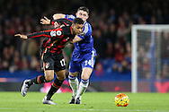 Joshua King of Bournemouth goes past Gary Cahill of Chelsea. Barclays Premier league match, Chelsea v AFC Bournemouth at Stamford Bridge in London on Saturday 5th December 2015.<br /> pic by John Patrick Fletcher, Andrew Orchard sports photography.