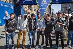 Elite runners meet and greet spectators at the finish line. Wes Korir, Meb Keflezighi, Lelisa Desisa, Caroline Rotich