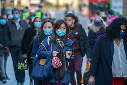 © Licensed to London News Pictures. 15/10/2020. London, UK. Commuters wearing masks arrive at Victoria Station, London, head to their offices as the Capital moves to Covid Tier Two restriction from midnight Friday. Millions of people will be put into Tier Two lockdown which bans households from mixing from midnight Friday as coronavirus levels of infections continue to escalate throughout the UK. Photo credit: Alex Lentati/LNP