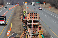 Men work on the bridge support in the middle of Route 17 in Monticello as part of the New York State Department of Transportation exit 106 reconstruction project on Thursday, March 17, 2011. The photograph was taken from the current bridge that carries County Road 173 (also known as East Broadway and Old Route 17) over Route 17.