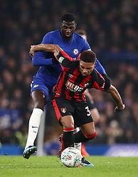Chelsea's Tiemoue Bakayoko (top) and AFC Bournemouth's Jordon Ibe battle for the ball during the Carabao Cup Quarter Final at Stamford Bridge, London.