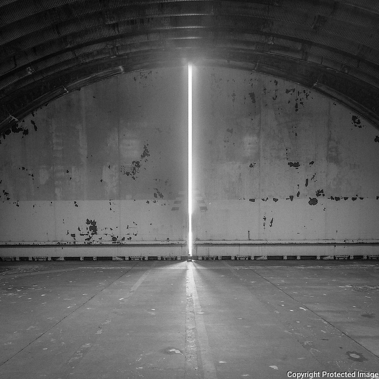From the series Spaces of Fear: Heyford, 2014. During the Cold War RAF Upper Heyford was a Quick Reaction Alert Facility where crews sat for four hour shifts in nuclear-armed F-111 bombers, engines running in the middle of the Oxfordshire countryside ready to respond to any Soviet threat at a moments notice. Signed and editioned prints available at 42x42cm, 80x80cm & 110x110cm.
