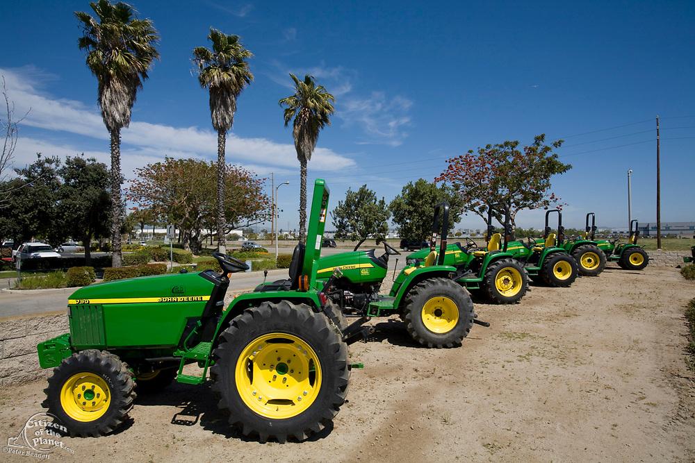 New Tractors lined up outside of a John Deere dealership, Oxnard, Ventura County, California, USA
