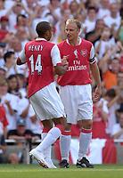 Photo: Daniel Hambury.<br />Arsenal v Ajax. Dennis Bergkamp Testimonial. 22/07/2006.<br />Arsenal's Dennis Bergkamp celebrates with Thierry Henry.