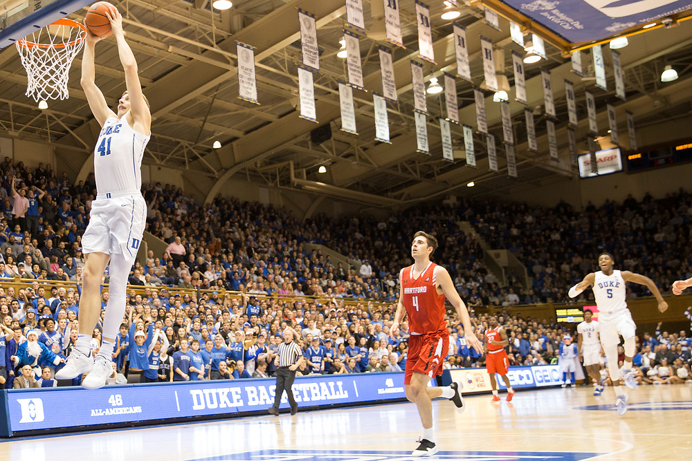 Jack White dunks while everyone looks on during the Duke Blue Devils' home game against the Hartford Hawks on December 5, 2018.