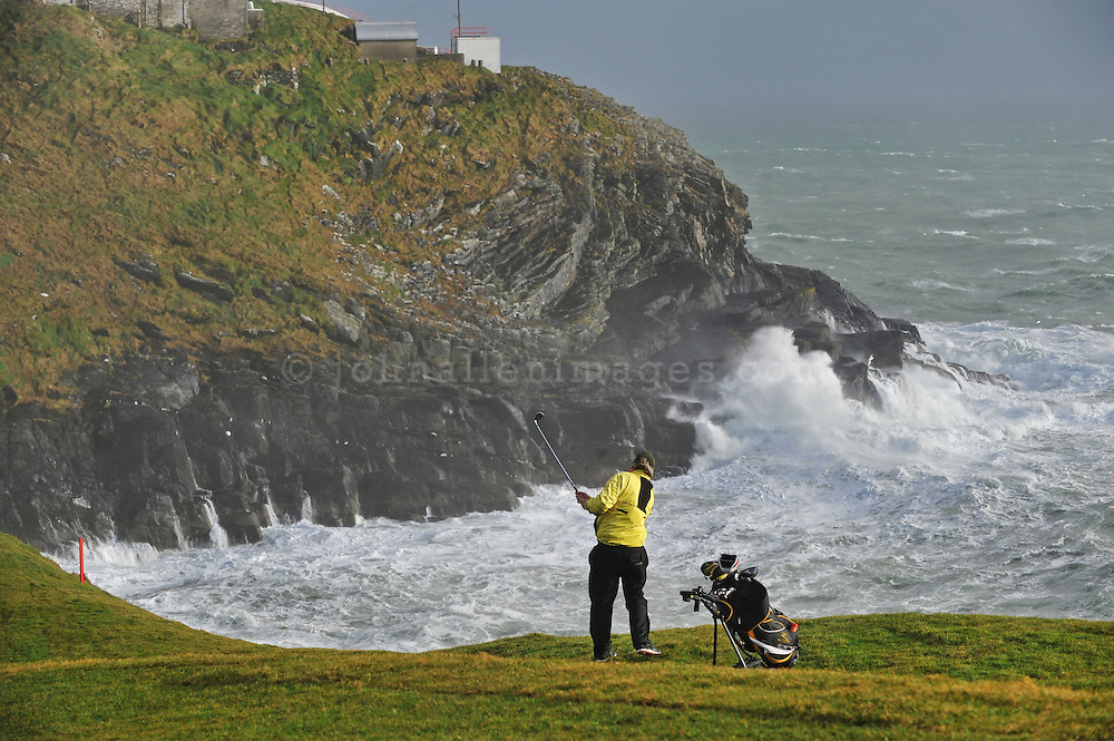Golfers at the Old Head of Kinsale on a windy day.<br /> Picture. John Allen