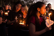 Members of the Stoneman Douglas Eagle Regiment mourn among thousands of other community members during a candlelight vigil at the Pine Trails Park amphitheater Thursday, Feb. 15, 2018, a day after the mass shooting at Marjory Stoneman Douglas High School in Parkland. A former student killed seventeen people, and inured several others, during the shooting. (XAVIER MASCAREÑAS/TREASURE COAST NEWSPAPERS)