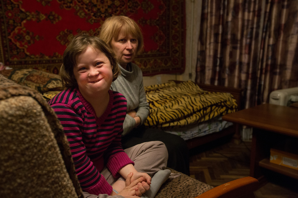 """CAPTION: Eva has Downs Syndrome. Her mother Tatyana was one of the first mothers to use the Short Break Service of Partnership for Every Child (P4EC) back in 2008, having heard about it at Tatyana's kindergarten. """"I don't even want to think about what I would do without the service"""", she says. """"It makes me feel unwell"""". LOCATION: St Petersburg, Russia. INDIVIDUAL(S) PHOTOGRAPHED: Eva Nikolayeva (daughter) and Tatyana Nikolayeva (mother)."""
