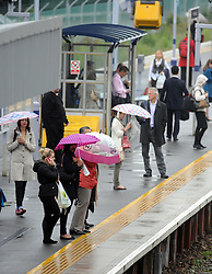 © Licensed to London News Pictures. 12/09/2013<br /> Wet weather in the South East this morning for Commuters at Pettswood train station,Greater London near Bromley.<br /> Photo credit :Grant Falvey/LNP