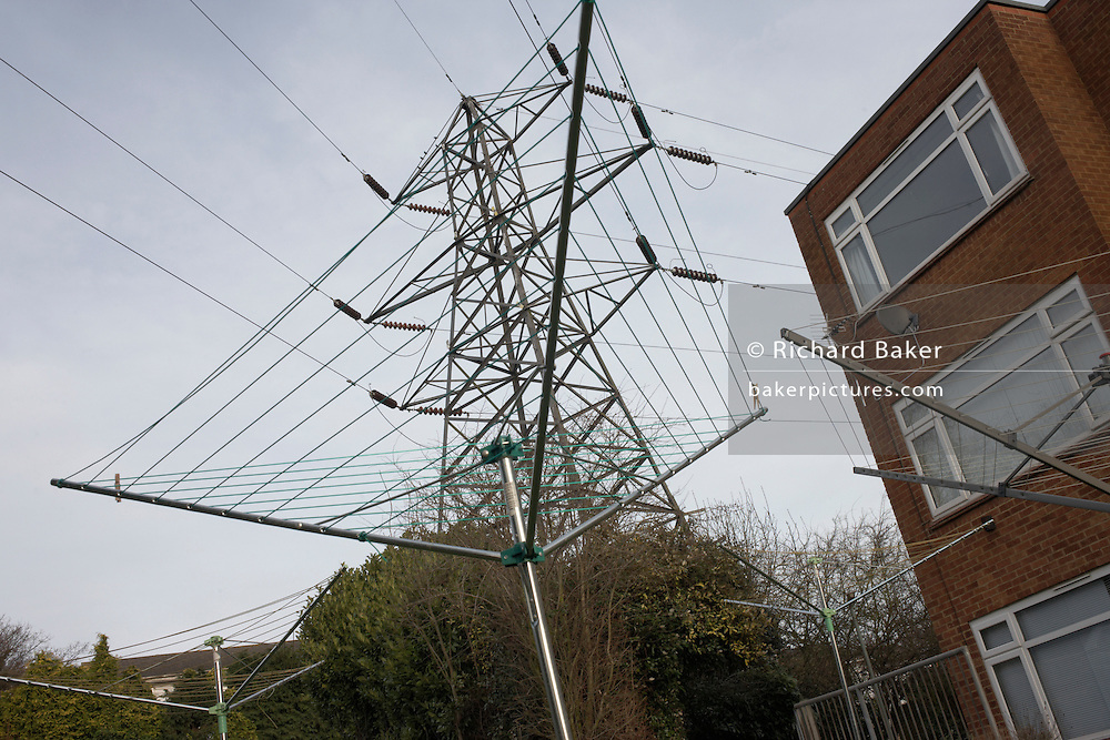 A clothes line merges with the lines of an electricity pylon near flats on the Hales Place estate in Canterbury