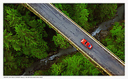seattle-pacific-northwest-automotive-photographer-randy-wells-location-and-studio-specialist-car-videographer-filmmaker-cinematographer-storyteller-writer, Aerial image of a red Porsche 911 S crossing a bridge and river, Washington state,  Pacific Northwest