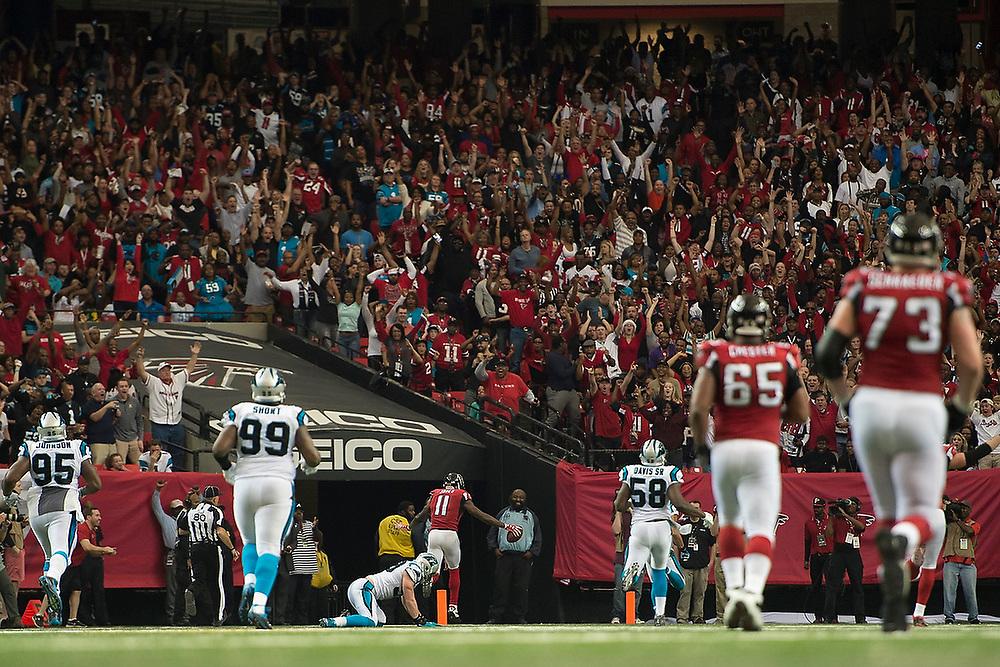 Atlanta's Julio Jones (11) celebrates as he crosses the goal line for a 70-yard touchdown. <br /> Carolina Panthers vs. Atlanta Falcons at The Georgia Dome in Atlanta, Ga. on Sunday, Dec. 27, 2015. <br /> Zach Bland/Auburn Athletics
