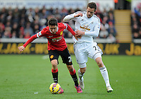 Manchester United's Ander Herrera vies for possession with Swansea City's Gylfi Sigur?sson<br /> <br /> Photographer Ashley Crowden/CameraSport<br /> <br /> Football - Barclays Premiership - Swansea City v Manchester United - Saturday 21st February 2015 - Liberty Stadium - Swansea<br /> <br /> © CameraSport - 43 Linden Ave. Countesthorpe. Leicester. England. LE8 5PG - Tel: +44 (0) 116 277 4147 - admin@camerasport.com - www.camerasport.com