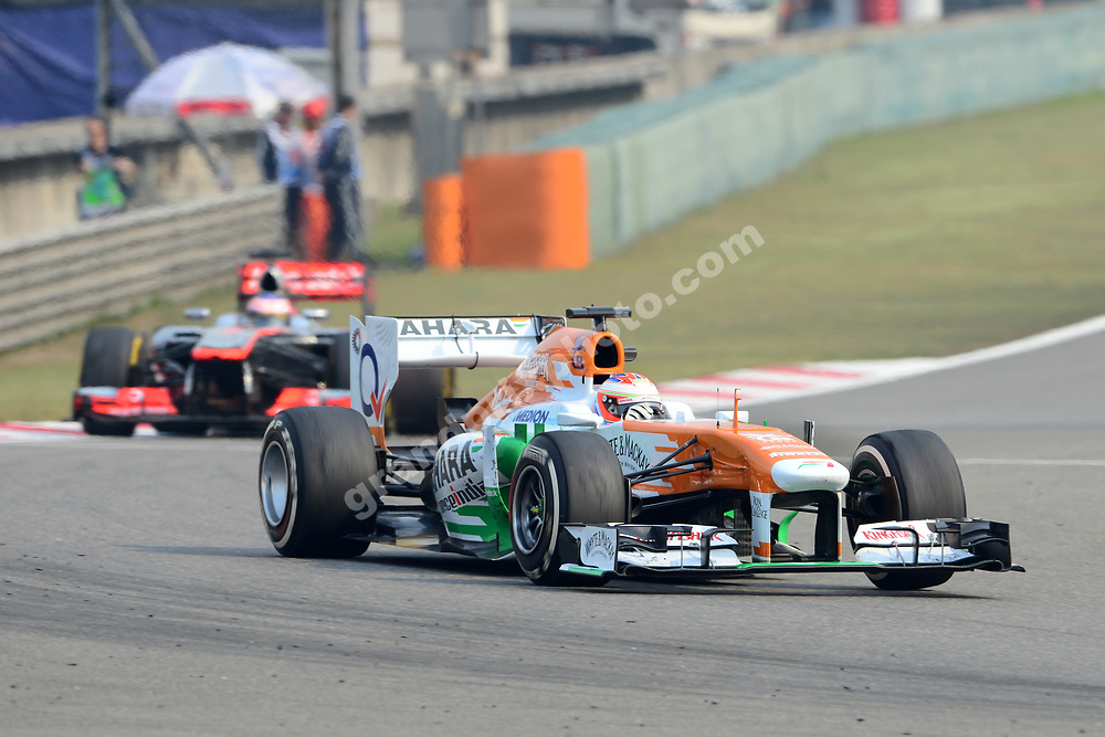 Paul di Resta (Force India-Mercedes) leads Jensn Button (McLaren-Mercedes) during practice for the 2013 Chinese Grand Prix in Shanghai. Photo: Grand Prix Photo
