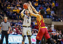Mar 6, 2019; Morgantown, WV, USA; West Virginia Mountaineers guard Jordan McCabe (5) shoots a three pointer during the second half against the Iowa State Cyclones at WVU Coliseum. Mandatory Credit: Ben Queen-USA TODAY Sports