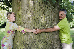 Apr. 08, 2008 - Couple hugging a tree, close up. Model and Property Released (MR&PR) (Credit Image: © Cultura/ZUMAPRESS.com)