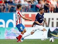 Atletico de Madrid's Gabi against Stromsgodset's Anders Konradssen during UEFA Europa League third qualifying round match. July 28, 2011. (ALTERPHOTOS/Alvaro Hernandez)