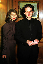 Actress CHARLOTTE RAMPLING and her son MR BARNABY SOUTHCOMBE, at a party in London on 24th November 1999.MZH 29