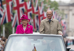 File photo dated 12/06/16 of Queen Elizabeth II and the Duke of Edinburgh making their way down The Mall in an open topped Range Rover, during the Patron's Lunch in central London in honour of the Queen's 90th birthday. Prince Philip's final public engagement takes place on Wednesday, before he retires at the age of 96.