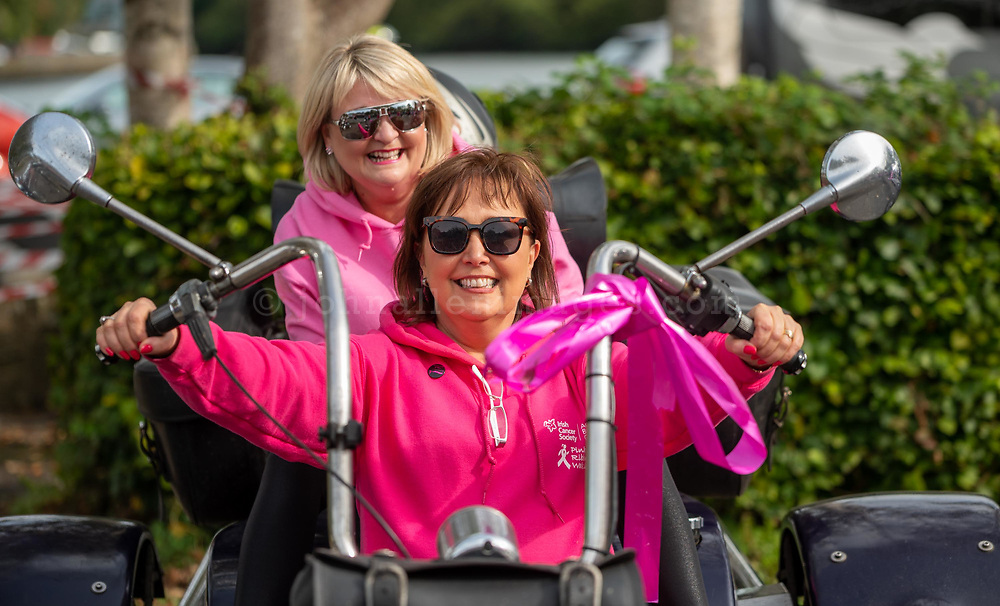 REPRO FREE<br /> Helen O'Brien and Fiona O'Mahony, Chair of the Kinsale Pink Ribbon Walk on a tree from the Shamrock Rose Motorcycle Club at the 2019 Kinsale Pink Ribbon Walk in aid of the Irish Cancer Society Action Breast Cancer.<br /> Picture. John Allen