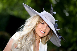 A racegoer arrives during day five of Royal Ascot at Ascot Racecourse.