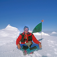 Gordon Wiltsie sits atop one of the highest peaks of Chile's previously unexplored Cordillera Sarmiento at the tip of Patagonia's southern icecap (Hielo Sur.)