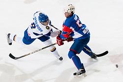 Talgat Zhailauov of Kazakhstan vs Mitja Robar of Slovenia at ice-hockey match between Slovenia and Kazahstan, on April 12, 2011 at Hala Tivoli, Ljubljana, Slovenia. (Photo By Matic Klansek Velej / Sportida.com)