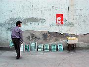 Selling photographs near Duyun, Guizhou Province, China.