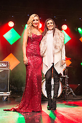 © Licensed to London News Pictures . 07/11/2015 . Manchester , UK . CATHERINE TYLDESLEY and KYM MARSH on stage for the Christmas Lights switch on at Albert Square in front of Manchester Town Hall . Photo credit : Joel Goodman/LNP