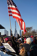 January, 21st, 2017 - Paris, Ile-de-France, France: Women democrats abroad carry placard with 'Substantive change but will not settle for being killed'. American flag and Eiffel tower behind. Thousands of protesters in Paris join anti-Trump Women's March around the world.